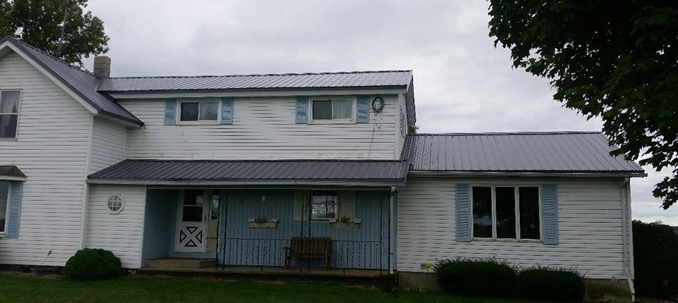 Manawa House Project with Steel Roofing Installed Over Shingle