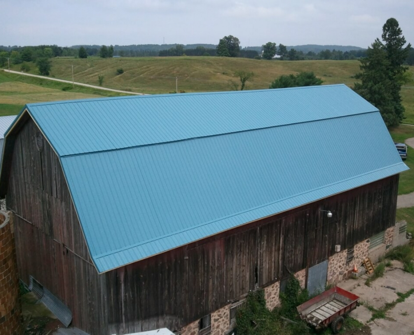 Marion Barn Roof After with GrandRib 3 Metal Panel in Caribbean Blue
