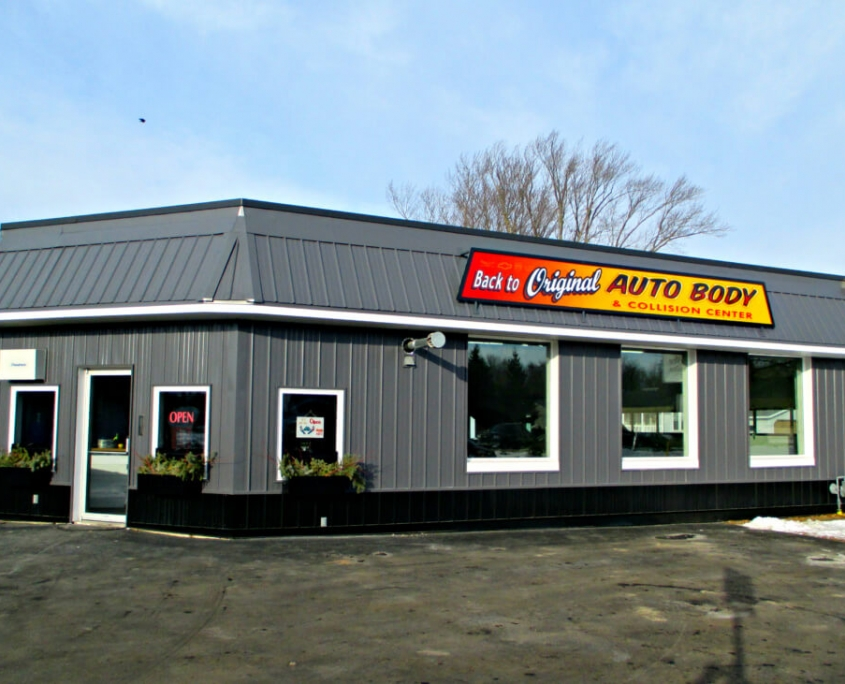 New London Commercial Building Exterior After with Charcoal Grey GrandRib 3 Panel