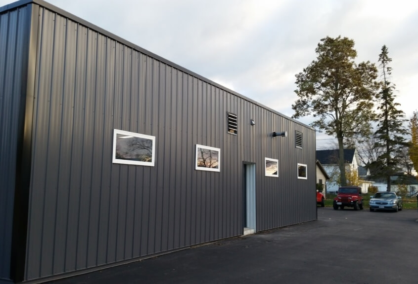 New London Commercial Building Exterior After with GrandRib 3 Panel in Charcoal Grey
