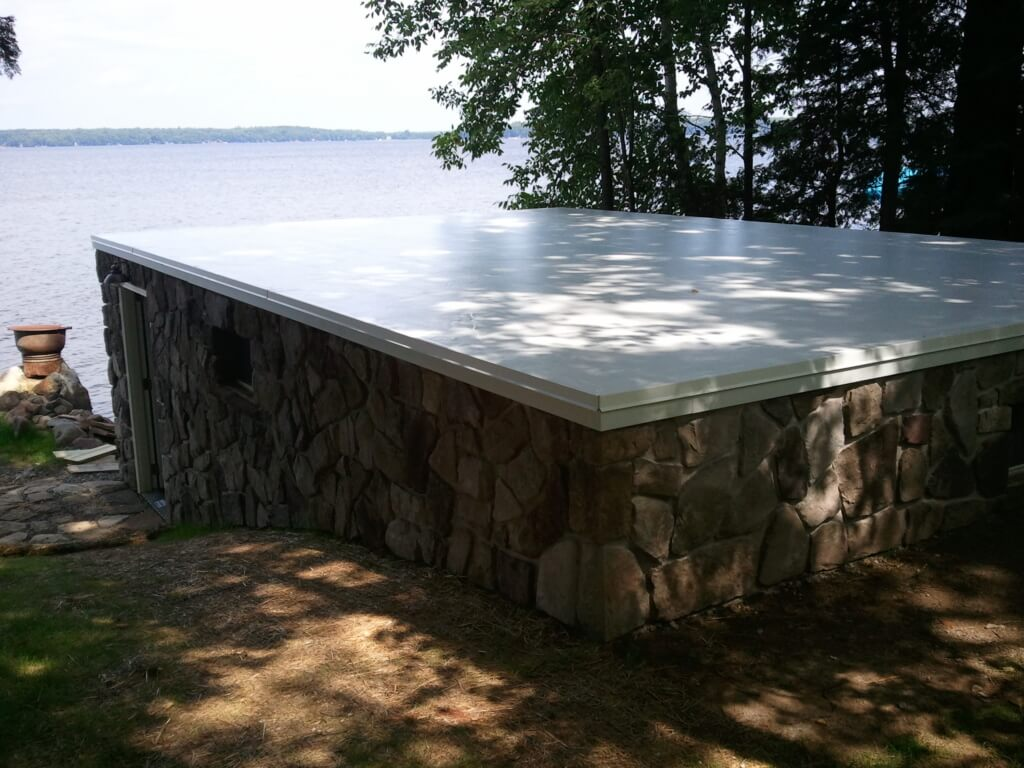 Pelican Lake Boat House Roof After with Duro-Last in White