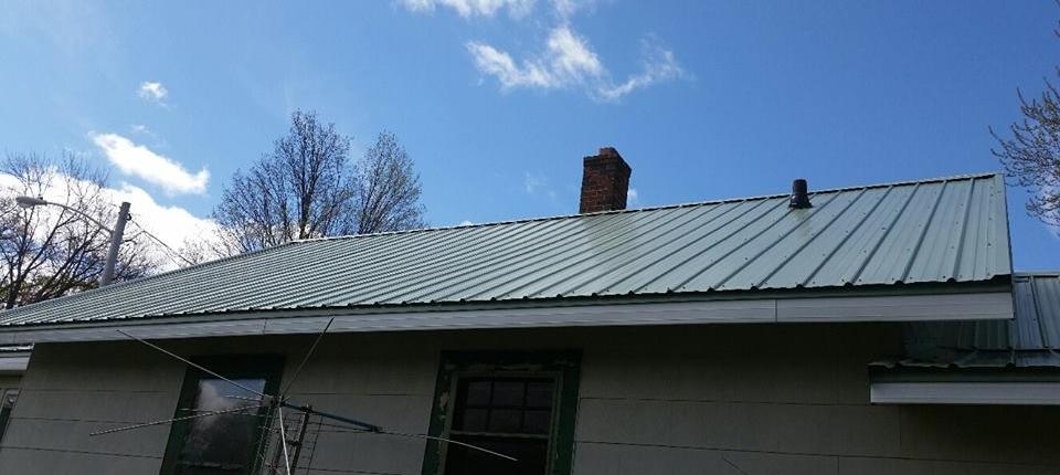 Sidewalk View of Metal Wisconsin House Roof