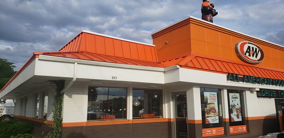 A&W Restaurant in Central Wisconsin with Orange Steel Roofing Installed by NCW