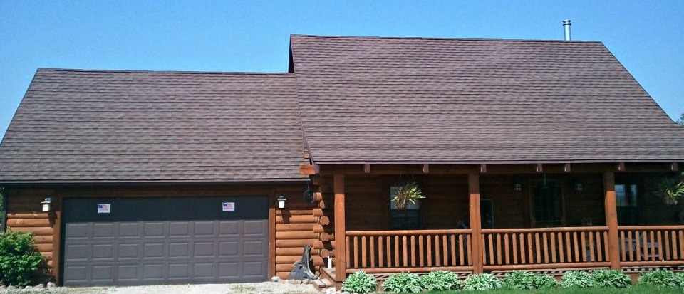 Sidewalk View of Wisconsin Residence with Stone-Coated Steel Shingle Roofing Installed by NCW
