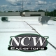 NCW Exteriors Logo Over Commercial Flat Roof in Wisconsin